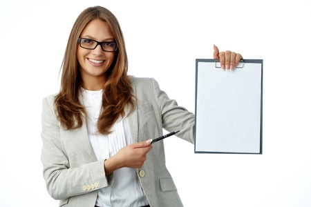 Pretty lady smiling at cam holding a clipboard with an attached blank photo