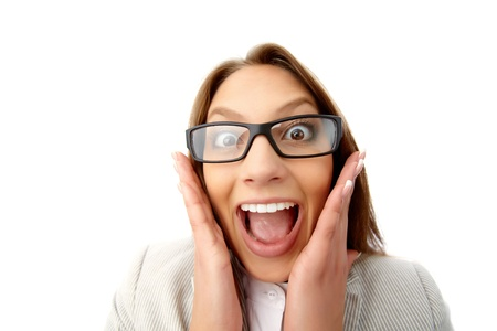 enormously: Close-up portrait of a girl in formalwear with funny look as if shocked or enormously excited Stock Photo