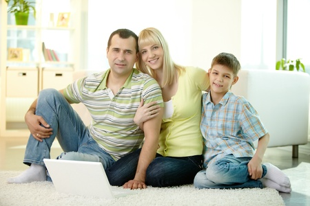 Family smiling at camera spending time at home together Stock Photo - 13313503