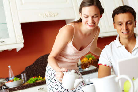 Tilt up of a cheerful young people having a breakfast together Stock Photo - 13313494