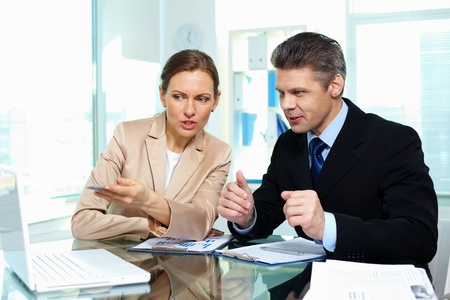 new strategy: Business partners discussing possible options in terms of a new strategy Stock Photo