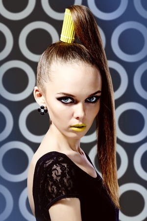 creativeness: Vertical shot of a girl wearing a high ponytail and yellow lipstick