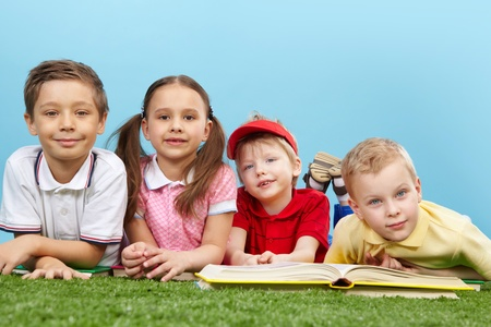 Cute guys and girl studying outside and looking at camera with a smile Stock Photo - 13408621