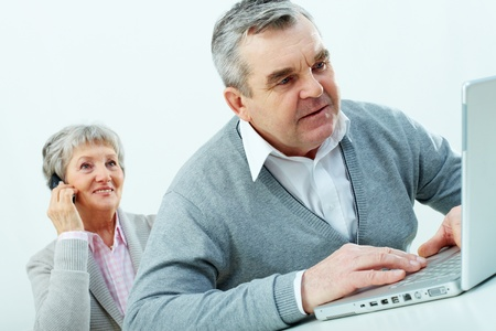 Senior people being comfortable with using modern gadgets photo