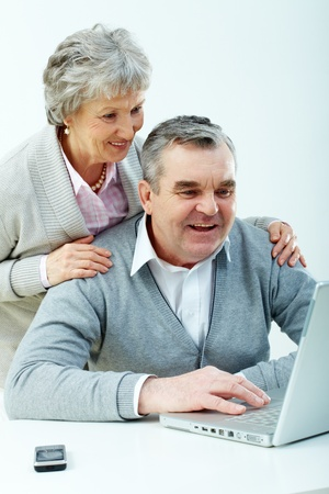 Senior couple learning how to use modern technology photo
