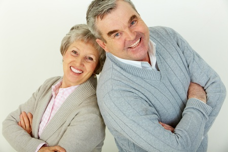 Cute senior family of two looking confidently at camera and smiling Stock Photo - 13408617