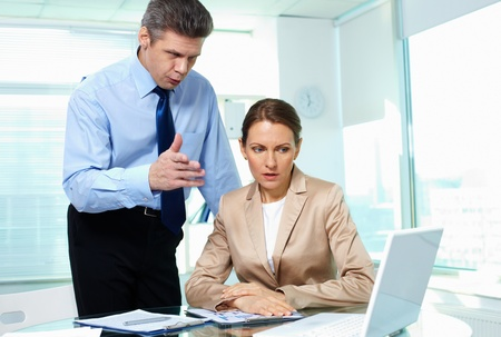 Formally dressed young people planning work in office Stock Photo - 13475986