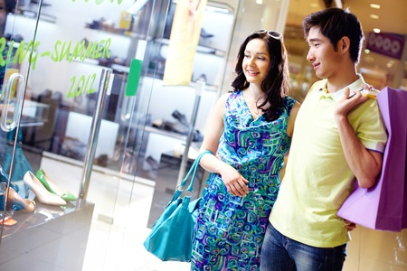 Shot of a smiling couple shopping in the mall photo
