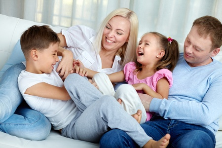 male parent: Portrait of happy family playing and laughing