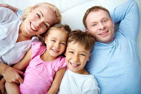 Portrait of happy family resting at home photo