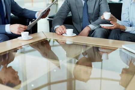 having a break: Business team having a break by cup of coffee Stock Photo