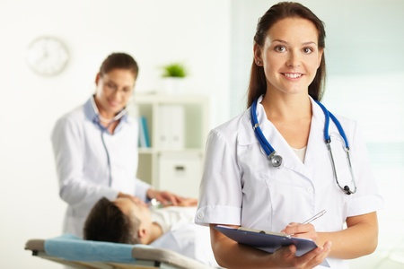 Portrait of confident female doctor looking at camera in hospital photo