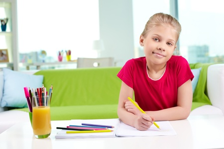 Portrait of lovely girl drawing with colorful pencils Stock Photo - 13589778