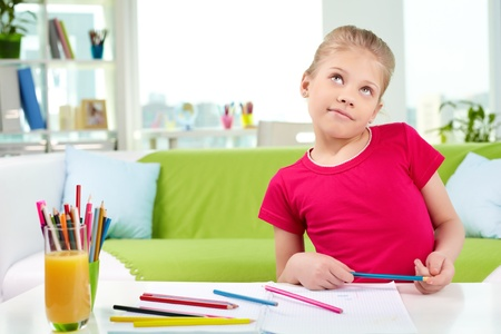 Portrait of pensive girl drawing with colorful pencils Stock Photo - 13589816