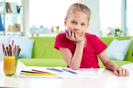 Portrait of lovely girl with colorful pencils looking at camera Stock Photo - 13589788