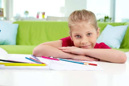 Portrait of lovely girl looking at camera with colorful pencils near by Stock Photo - 13589782