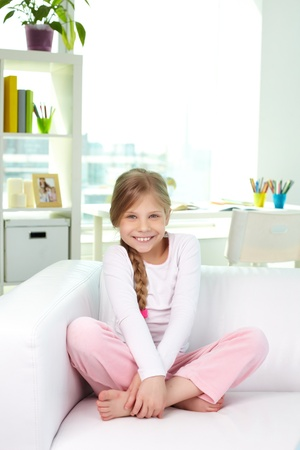Portrait of lovely girl looking at camera with smile at home Stock Photo - 13589745