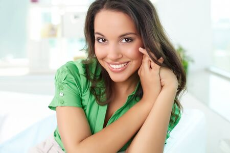 gorgeous businesswoman: Gorgeous woman looking at camera with smile Stock Photo