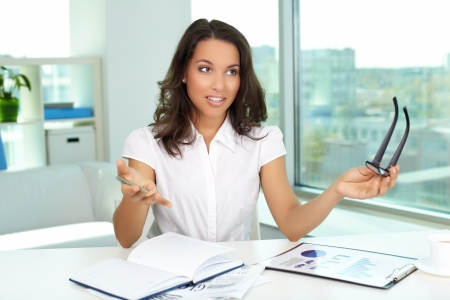 Portrait of businesswoman explaining her idea in office photo