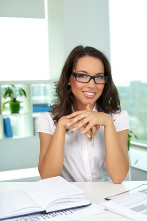 Portrait of successful businesswoman looking at camera in office photo