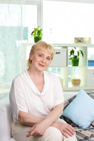 Portrait of restful aged woman looking at camera at home Stock Photo - 13631212