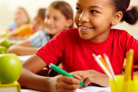 kids drawing: Row of pupils looking at teacher with cute girl in front Stock Photo