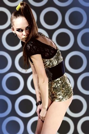 Gorgeous woman in glamorous clothing posing on retro background Stock Photo - 13729559