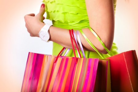 Image of shopaholic arm with three shopping bags Stock Photo - 13742369