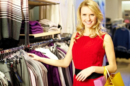 Portrait of pretty shopper looking at camera in clothing department Stock Photo - 13729548
