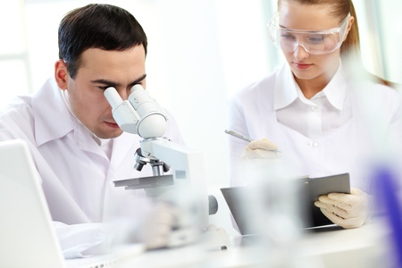 Serious clinicians studying chemical elements in laboratory Stock Photo - 13766764