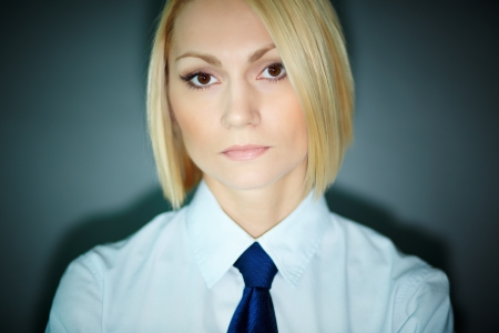Portrait of serious blonde woman looking at camera Stock Photo - 13766766
