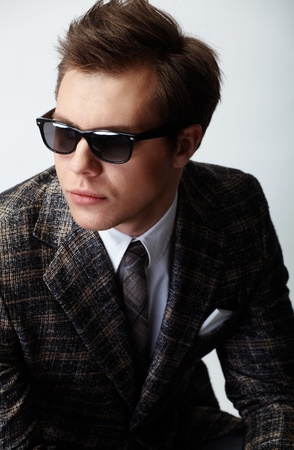 Image of elegant man posing in front of camera photo