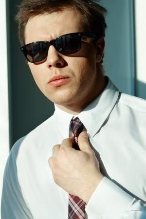 Image of elegant man looking at camera photo