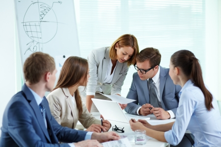 Image of confident partners discussing paper at meeting Stock Photo - 13766756