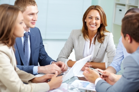 competitive business: Image of business partners discussing plans at meeting