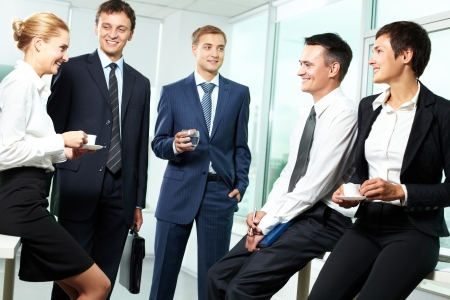 Business people interacting with each other in semi-formal situation Stock Photo - 13767189