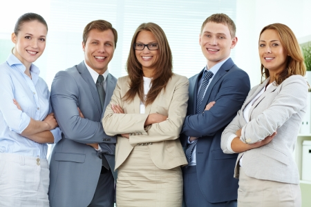 Portrait of five businesspeople looking at camera and smiling Stock Photo - 13857237