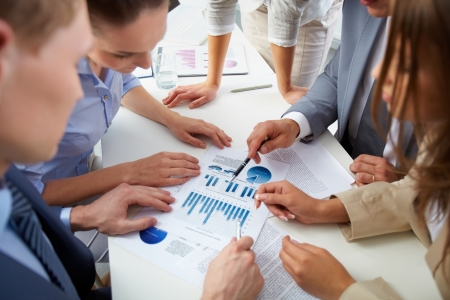 Image of business people discussing business documents at meeting Stock Photo - 13857340