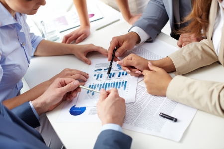resource: Image of human hands over business documents at meeting Stock Photo