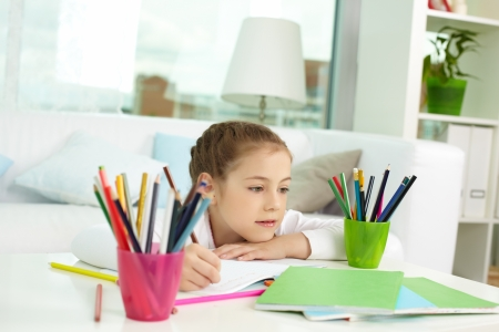 Portrait of lovely girl with colorful pencils near by Stock Photo - 13888763
