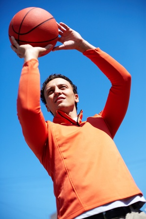 sporting activity: Image of young man with ball outside