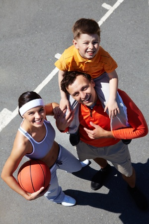 Portrait of happy family on playground photo