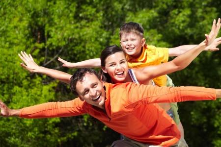 Portrait of happy family stretching arms