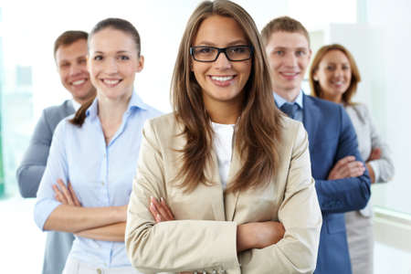 Close-up portrait of a business group with a female leader in the foreground Stock Photo - 13949860