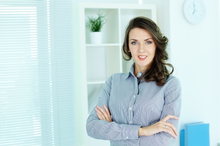 Business woman posing confidently in front of the camera photo