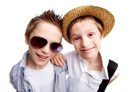 cool kids: Boys dressed casually going on summer vacations, isolated on white