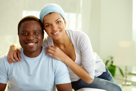 devoted: Image of young African couple looking at camera with smiles Stock Photo