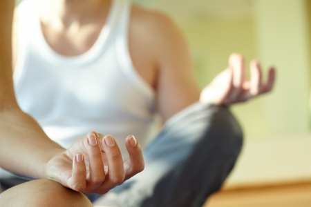 nirvana: Close-up of feminine and masculine arms during meditation Stock Photo