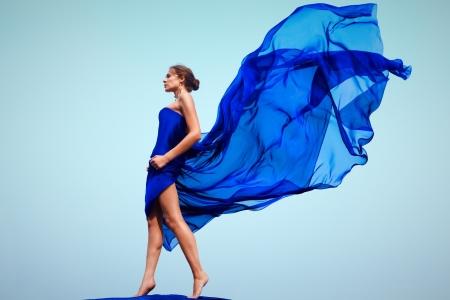 avantegarde: Photo of graceful female folded in dark blue chiffon shawl outside