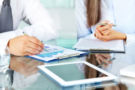 business consulting: Image of human hands during discussion of business documents at meeting Stock Photo
